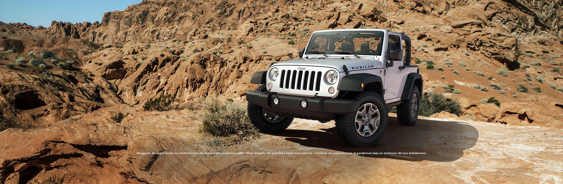 Se muestra Wrangler Unlimited Rubicon 10th Anniversary Edition 2013 en Billet Silver.